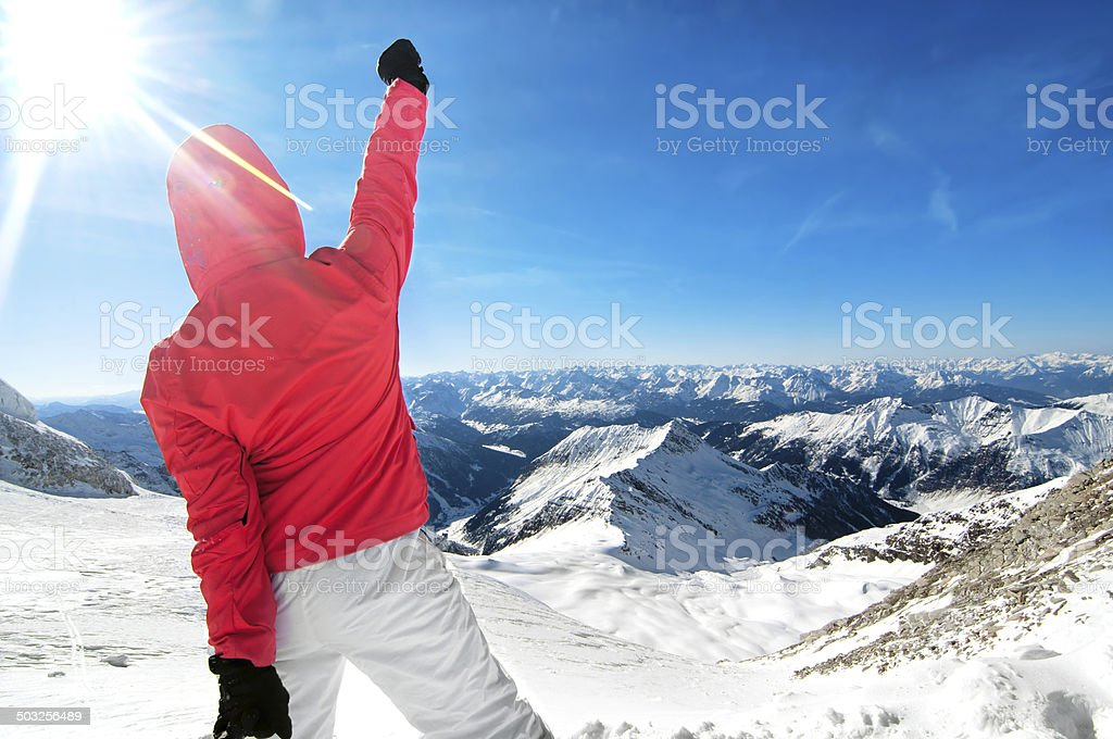 Beautiful young woman stands on top of the mountain stock photo