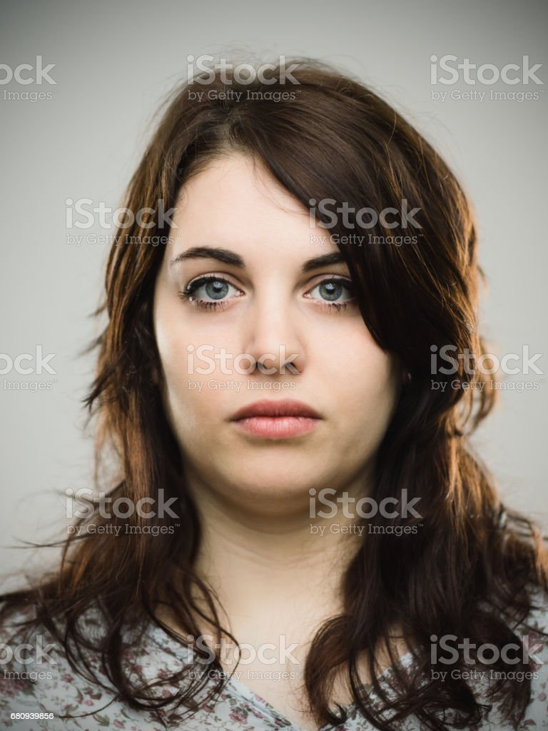 Beautiful young woman staring at camera stock photo