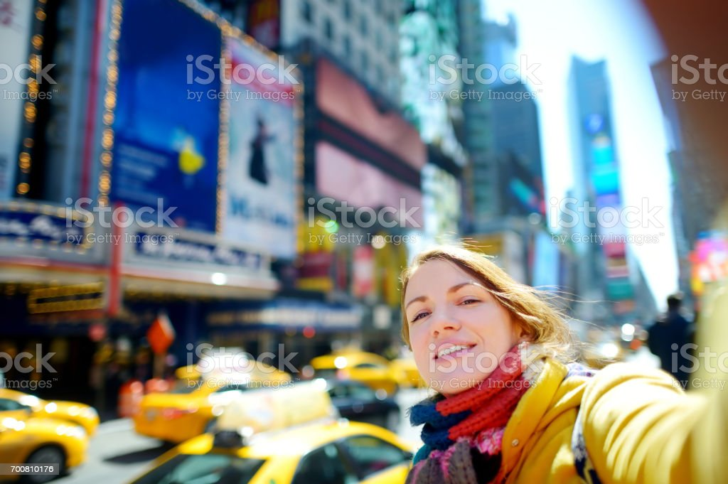 Beautiful young woman taking a selfie on Times Square, New York stock photo