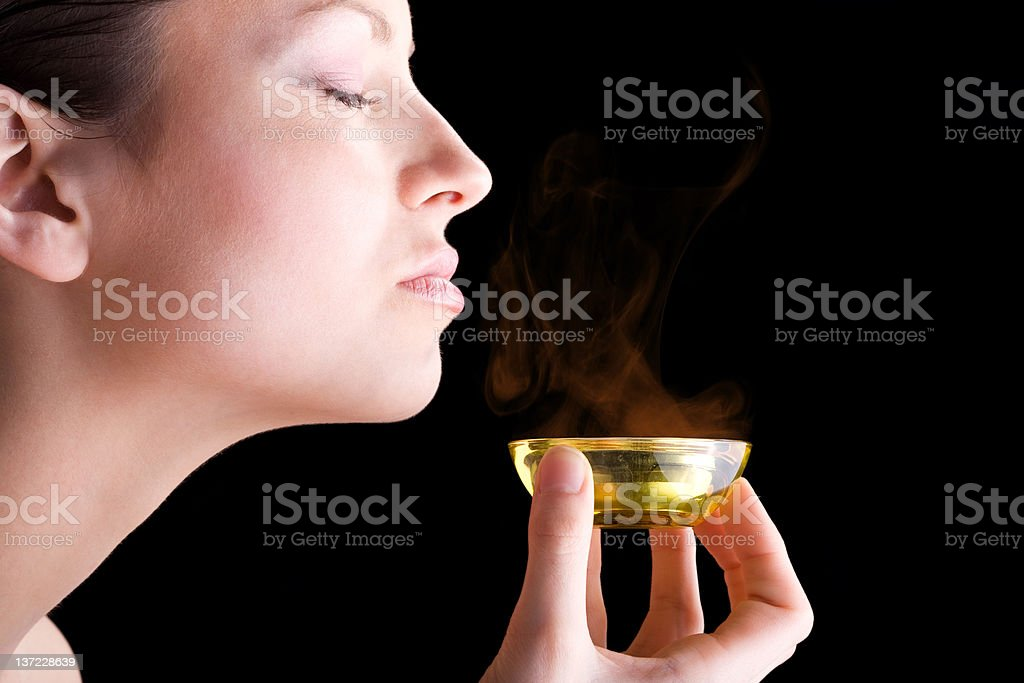 Beautiful young woman taking aroma therapy royalty-free stock photo