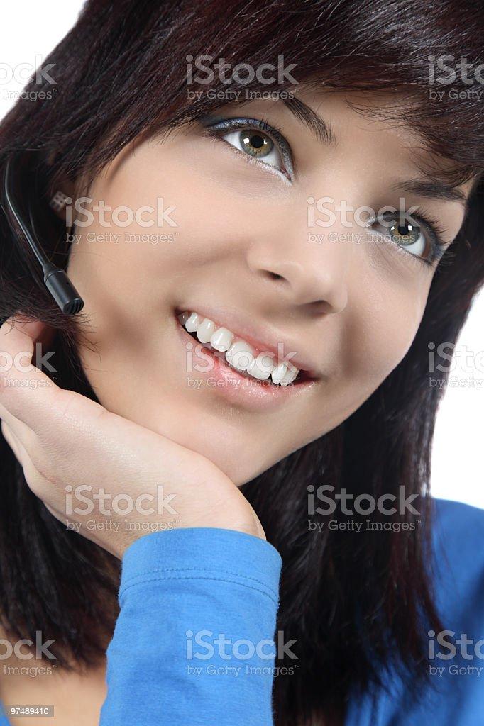 Beautiful young woman talking at speakerphone royalty-free stock photo
