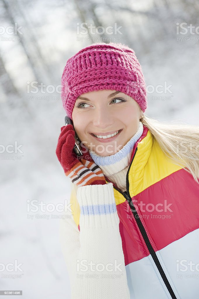 Beautiful young woman talking on her cellular phone royalty-free stock photo