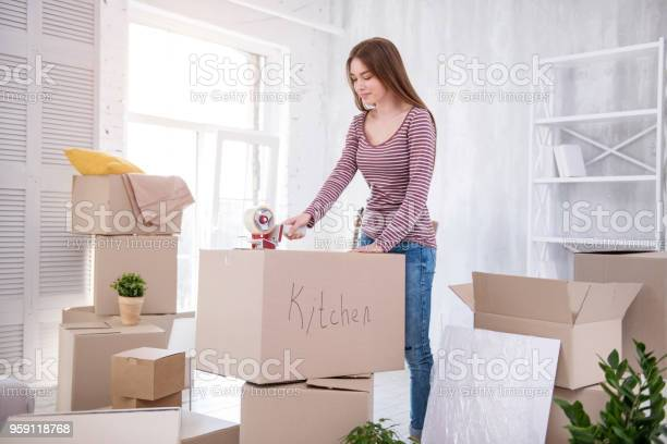 Beautiful young woman taping box with cutlery picture id959118768?b=1&k=6&m=959118768&s=612x612&h=t2uschibxedvsh4xh1qpyqniinvvj tw6rczpwdlewi=