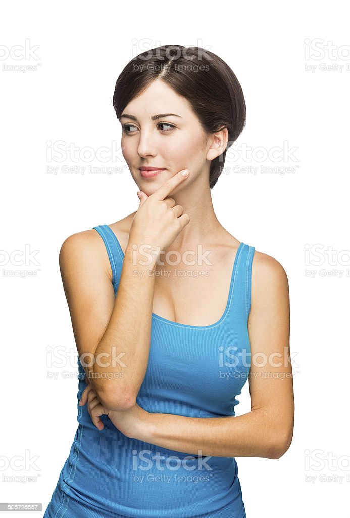 Beautiful young woman thinking stock photo