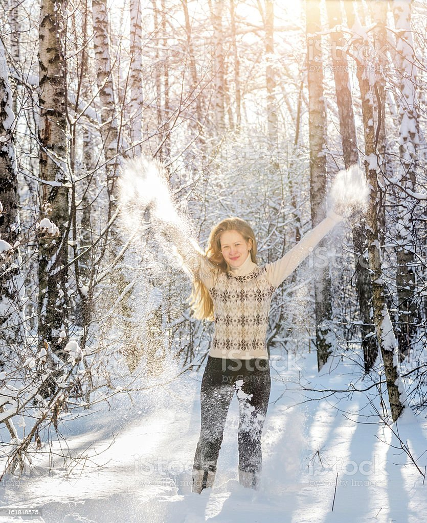 Beautiful young woman throwing snow into  air royalty-free stock photo