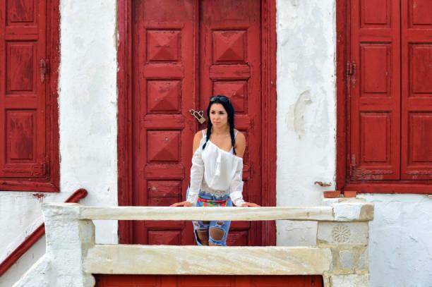 Beautiful young woman tourist in Mykonos, Greece stock photo