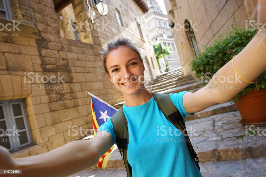 Beautiful Young Woman tourist taking selfie pictures  during Europe travel. stock photo