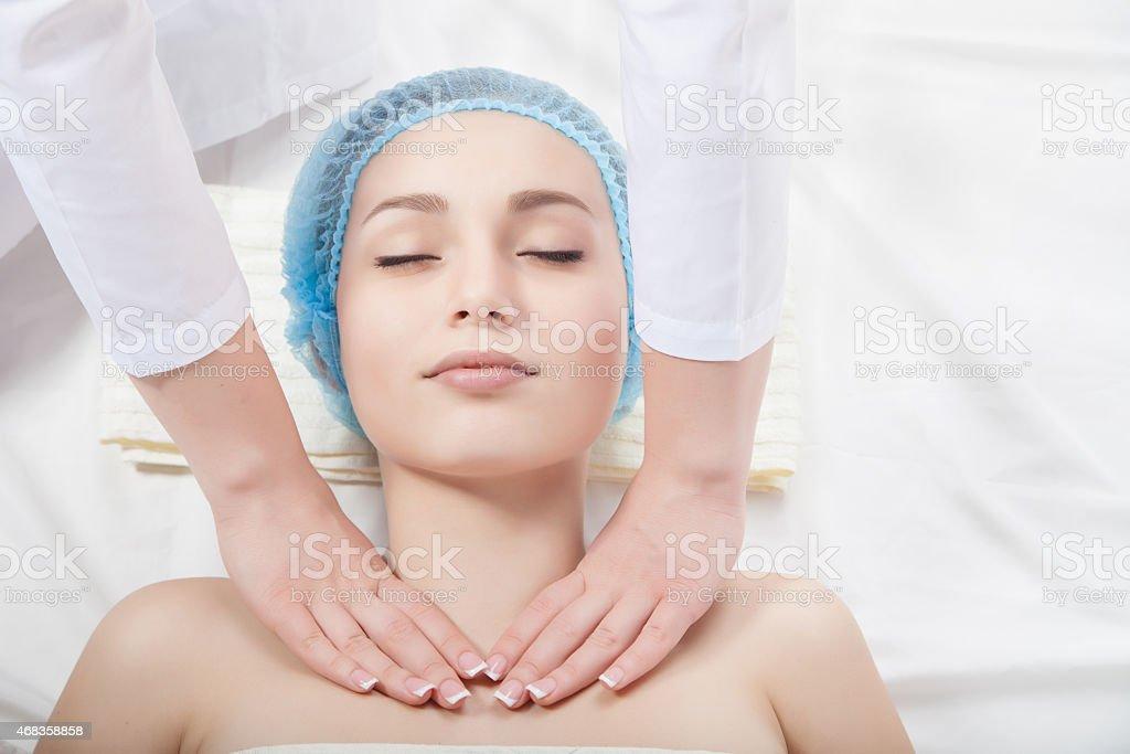 Beautiful young woman undergoing a massage royalty-free stock photo