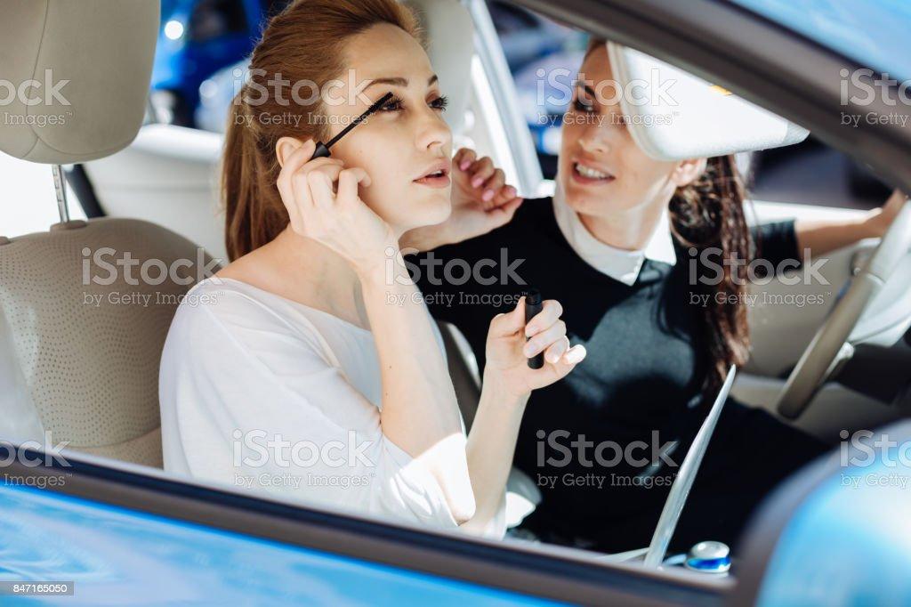 Beautiful young woman using mascara stock photo