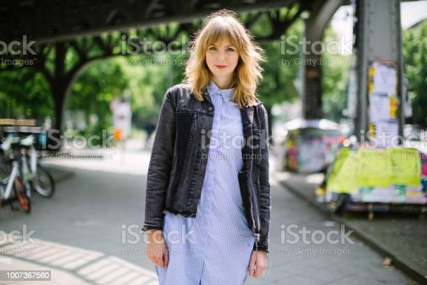 Beautiful young woman walking along city street picture id1007367560?b=1&k=6&m=1007367560&s=612x612&h=bkkf2ibfvn5h0nu4cf4jbbn8opfxsjhbubokikvl vy=