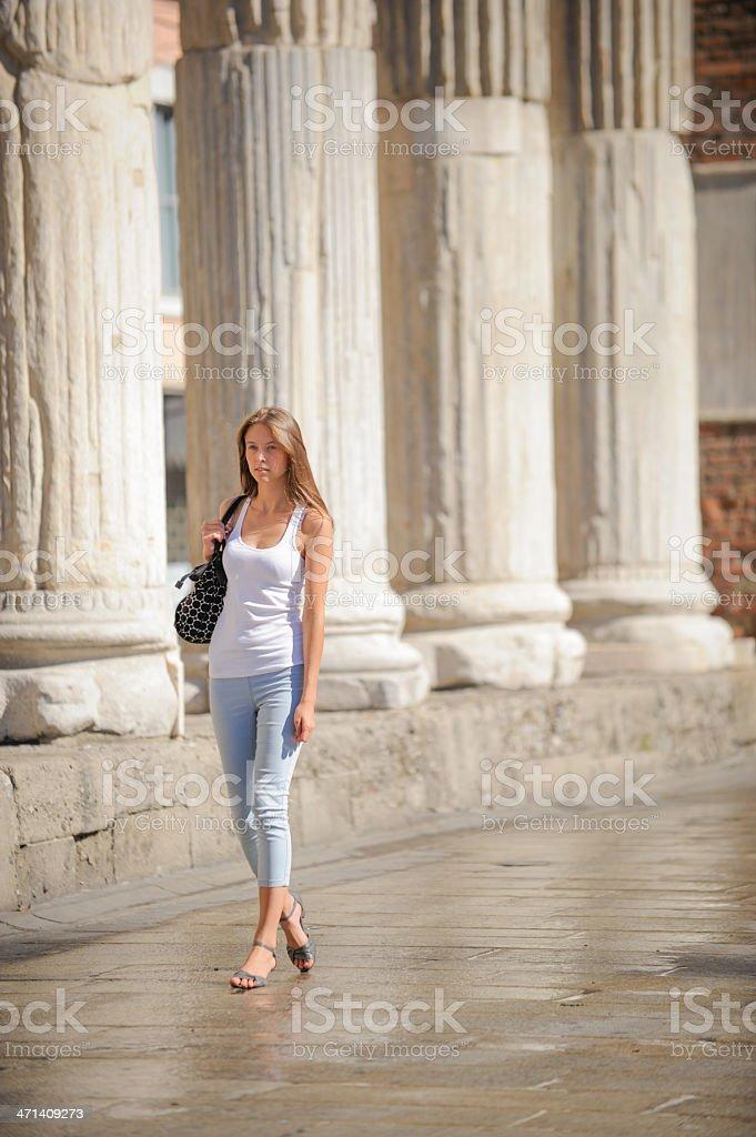 Beautiful Young Woman walking stock photo