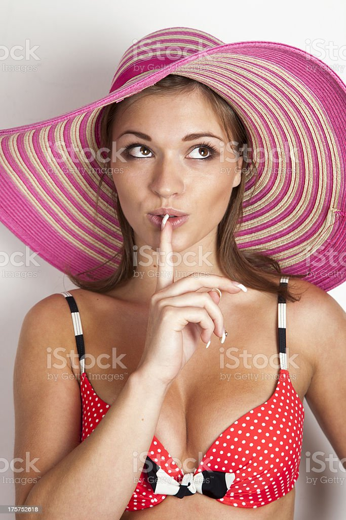 Beautiful young woman wearing a bikini and sun-hat. royalty-free stock photo