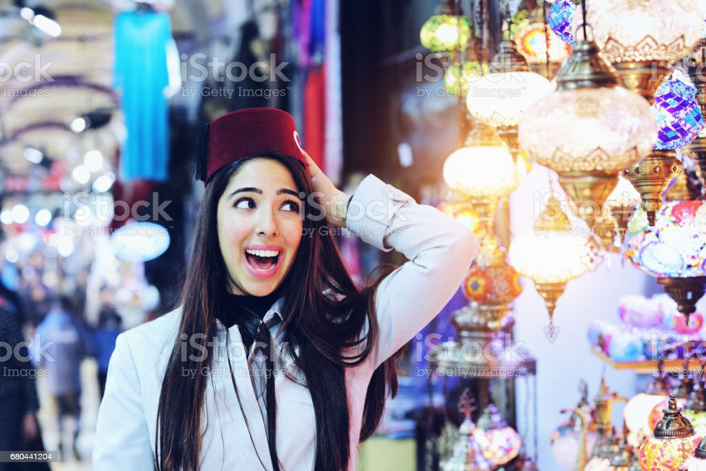 Beautiful Young Woman Wearing A Fez In Grand Bazaar Istanbul