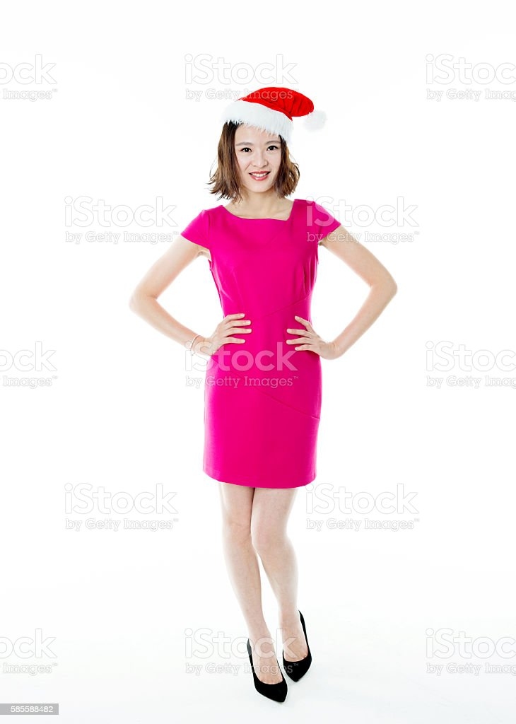 8eddcabedfa82 Beautiful Young Woman Wearing A Santa Hat Stock Photo   More ...