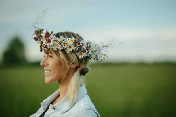 Beautiful young woman wearing flower wreath stock photo
