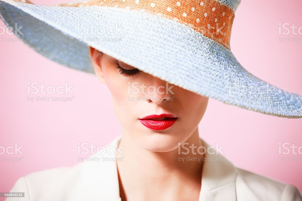 Beautiful young woman wearing hat stock photo