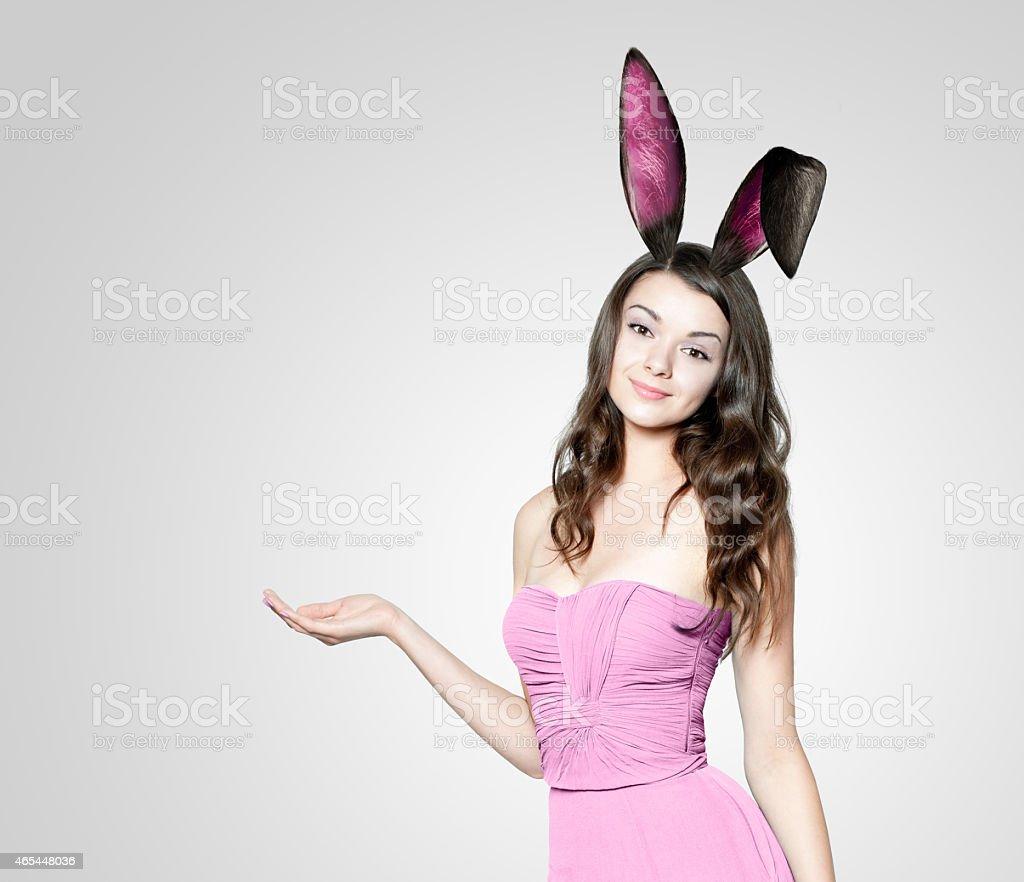 A beautiful young woman wearing rabbit ears stock photo