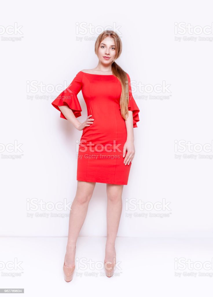 Beautiful young woman wearing stylish elegant red dress Full lenght body Studio portrait - Foto stock royalty-free di Abbigliamento casual
