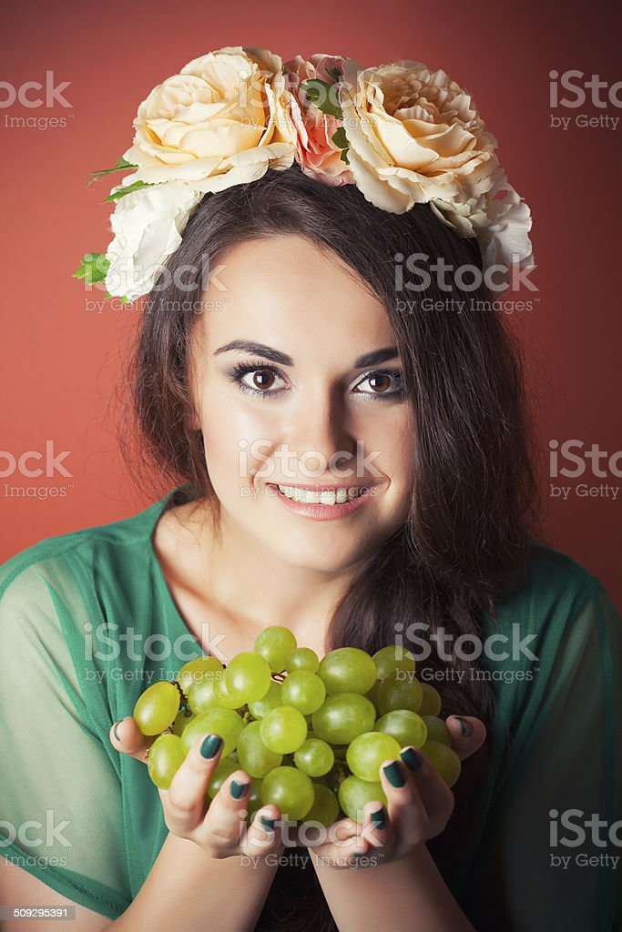 Beautiful Young Woman Wearing Wreath And Holding Green