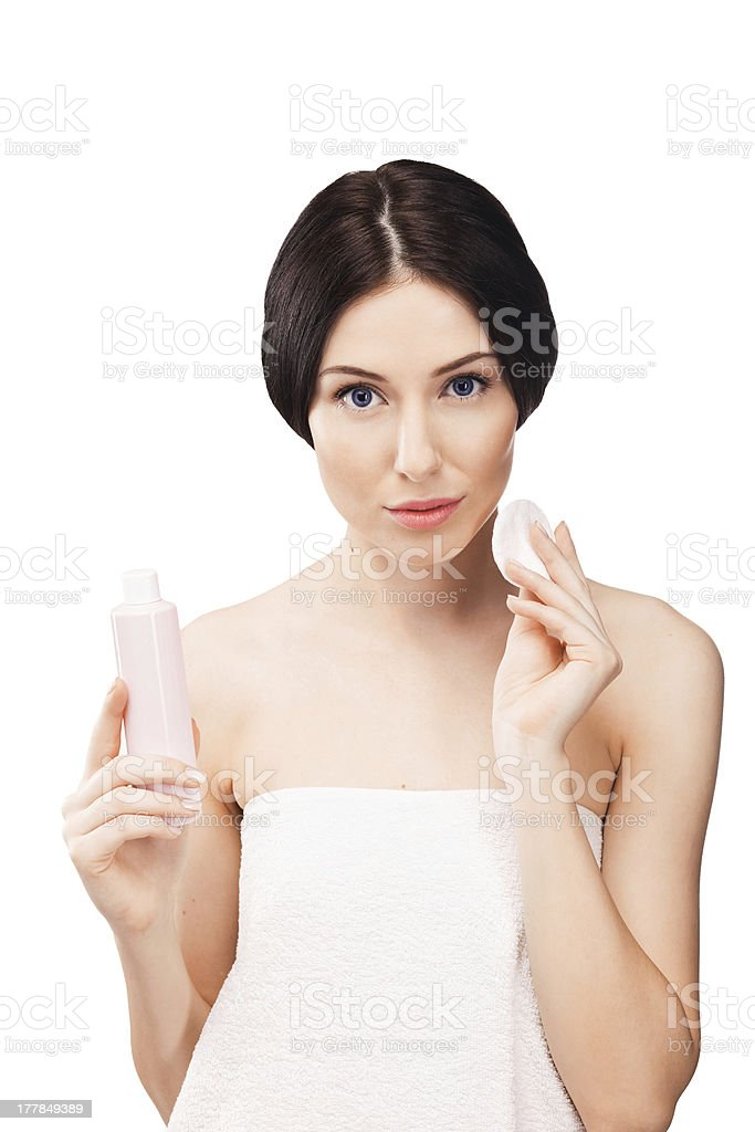 Beautiful young woman with a cream royalty-free stock photo