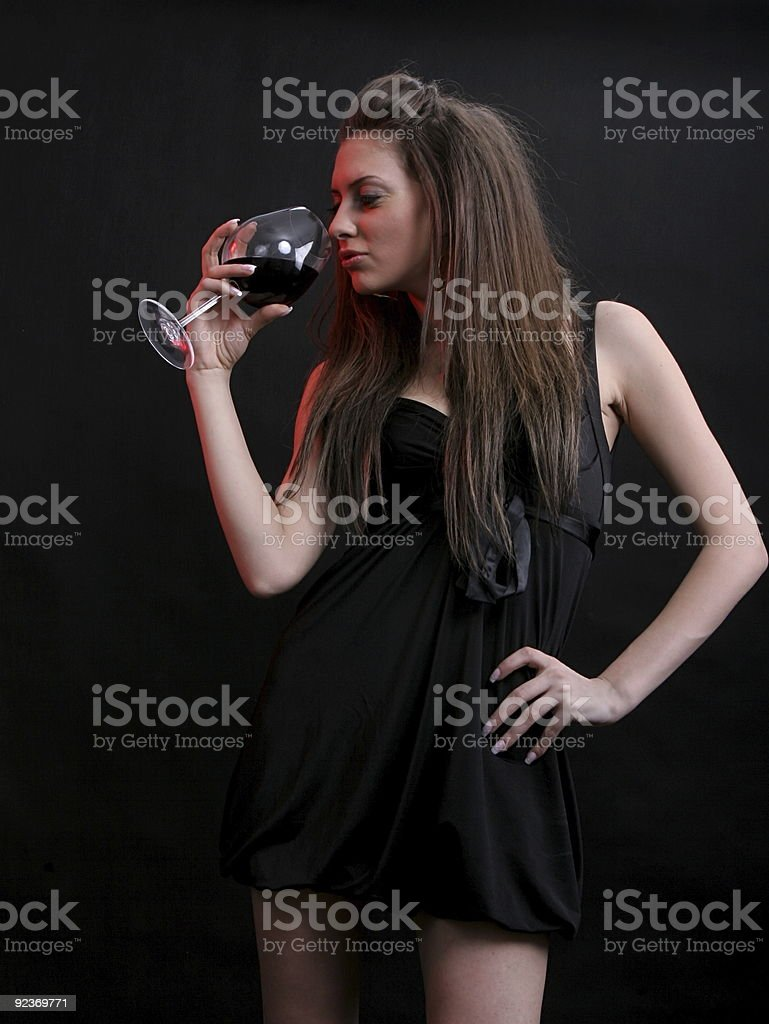 beautiful young woman with a glass of red wine. royalty-free stock photo