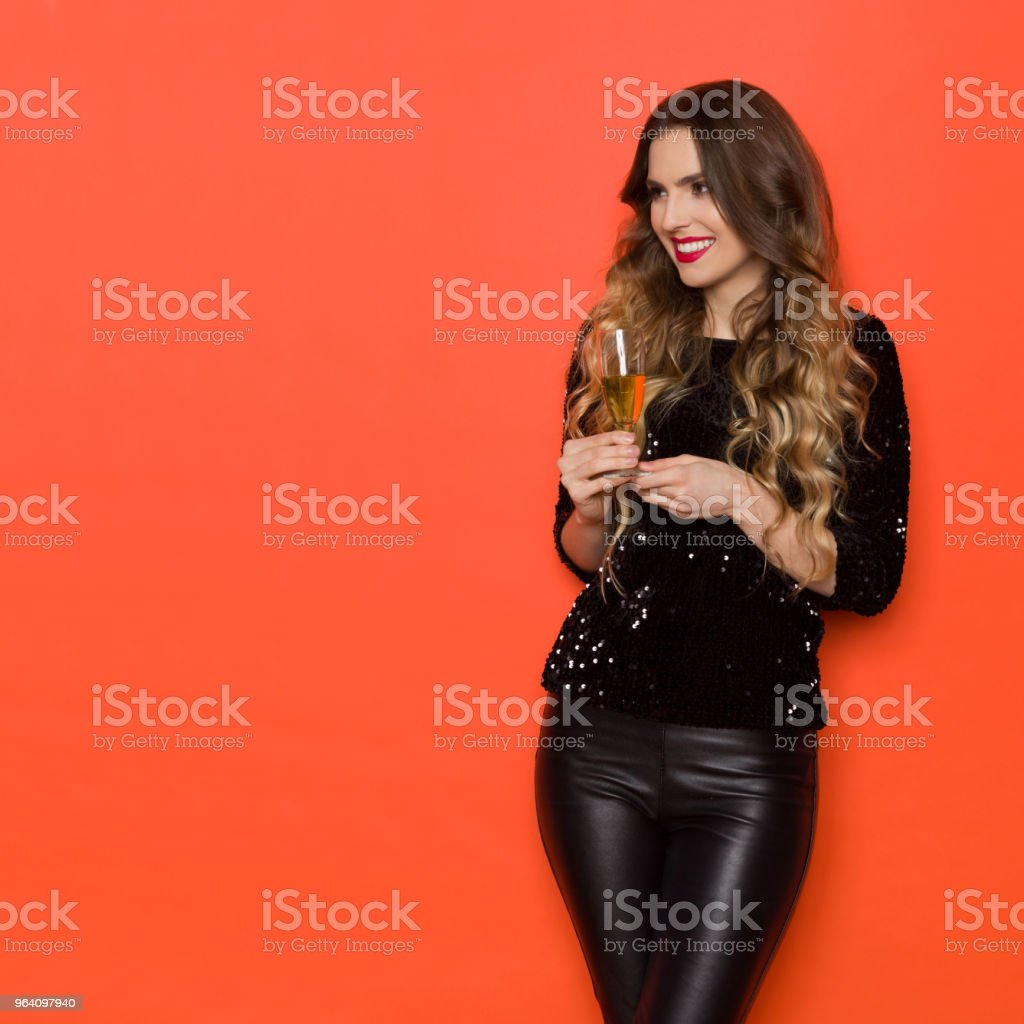 Beautiful Young Woman With A Glass Of Wine Is Looking Away - Royalty-free Adult Stock Photo
