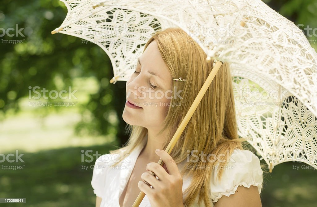 Beautiful young woman with a parasol royalty-free stock photo