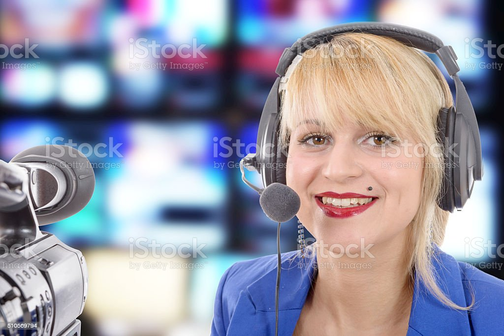 beautiful young woman with a professional video camera and headp stock photo