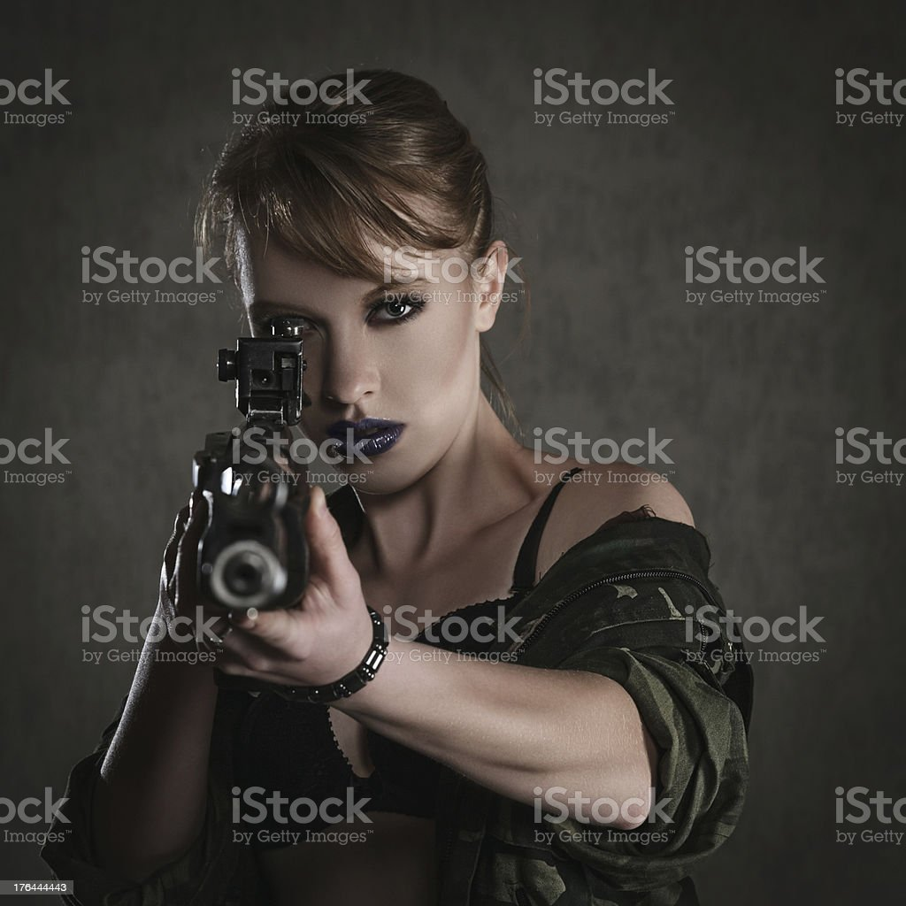 Beautiful young woman with a rifle royalty-free stock photo