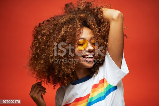 Beautiful young woman with afro hair in summer themes. Made in Barcelona with model from Venezuela.