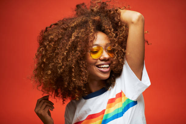 beautiful young woman with afro, reggaeton musician. - capelli ricci foto e immagini stock