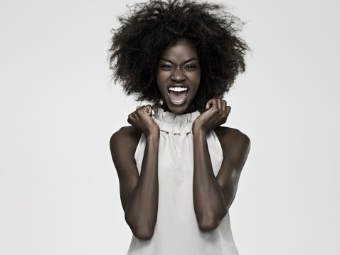 istock Beautiful young woman with an afro 92348246