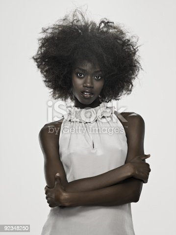 istock Beautiful young woman with an afro 92348250