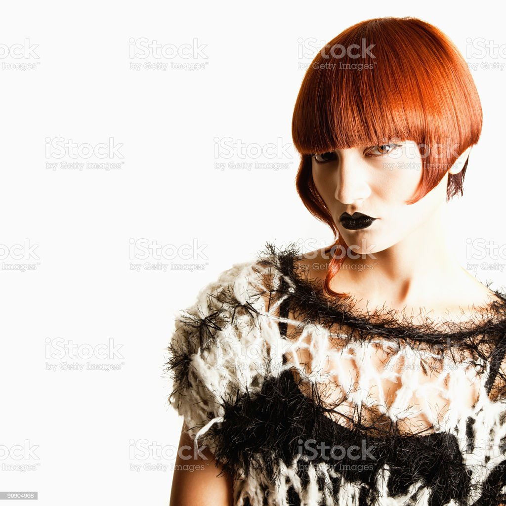 Beautiful Young Woman with Angular Hairstyle in Avant-Garde Attire royalty-free stock photo
