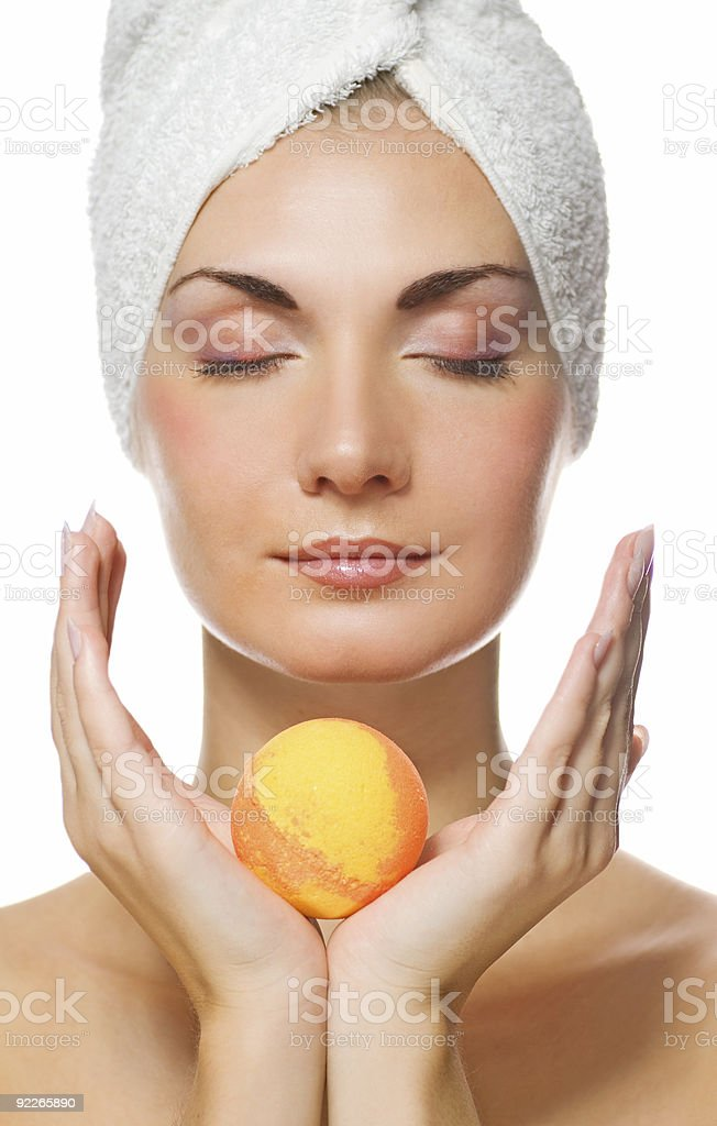 Beautiful young woman with aroma bath ball royalty-free stock photo