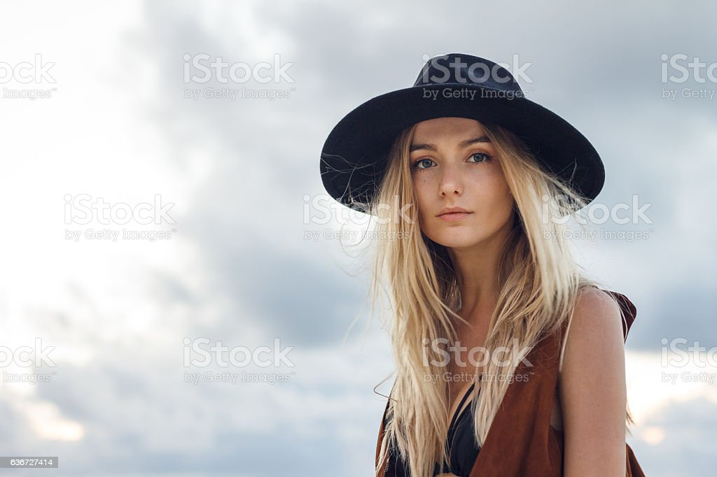 Beautiful young woman with black hat stock photo