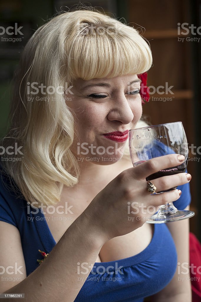 Beautiful Young Woman with Blond Hair Drinking Glass of Wine royalty-free stock photo