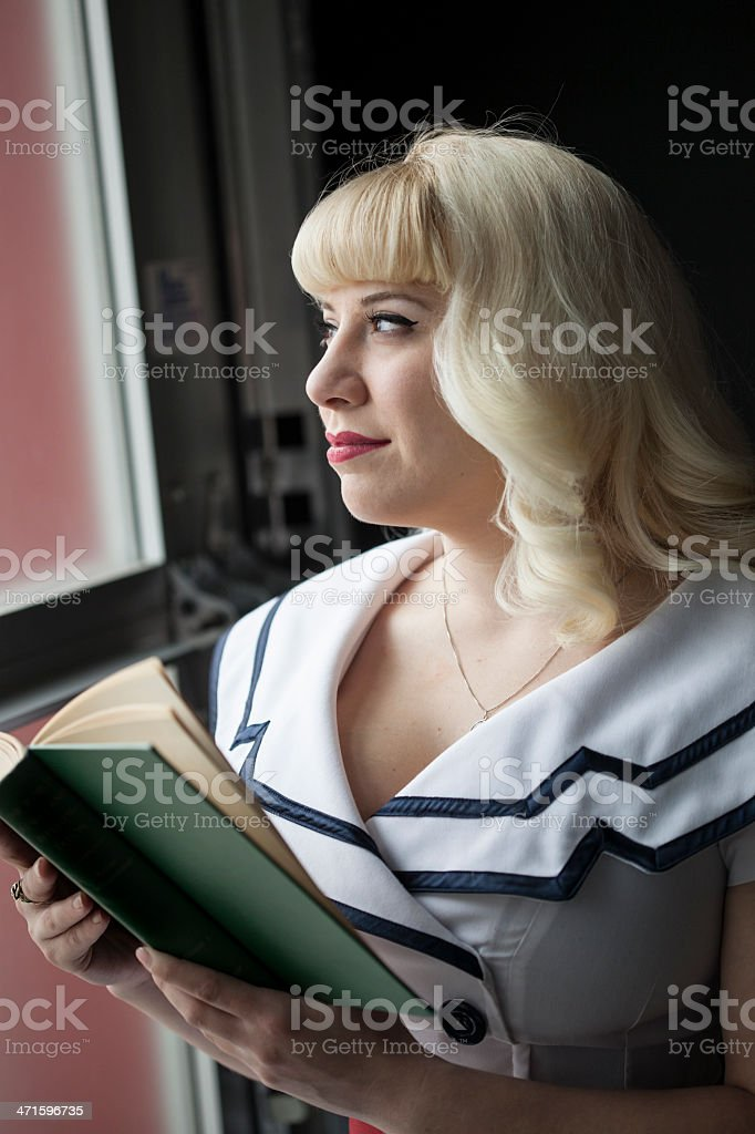 Beautiful Young Woman with Blond Hair Reading Book royalty-free stock photo