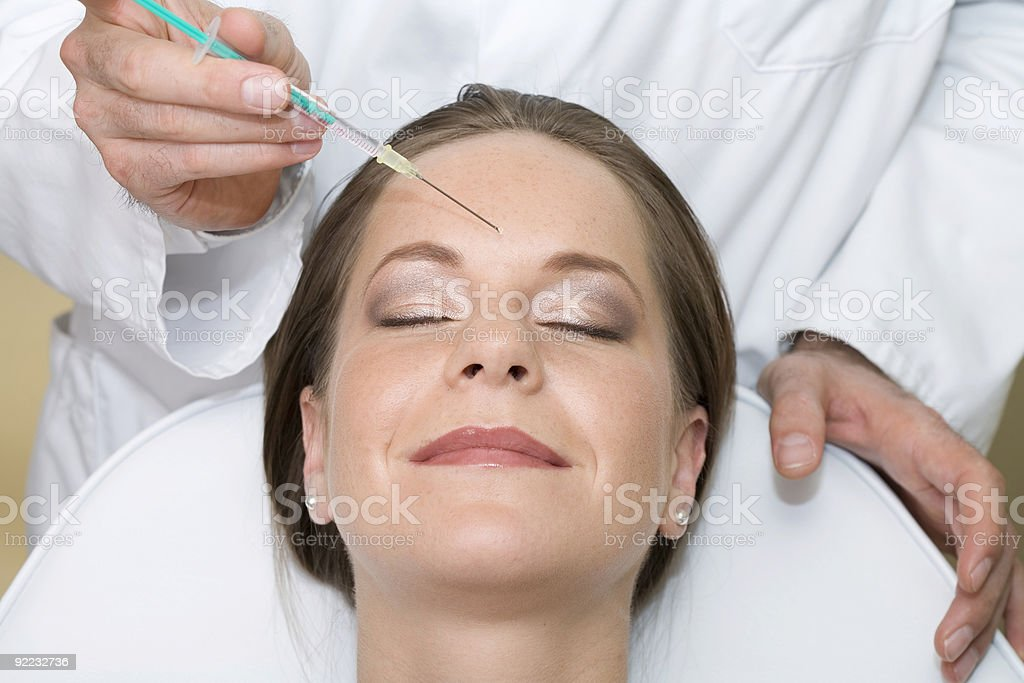 Beautiful young woman with Botox injection - closed eyes royalty-free stock photo