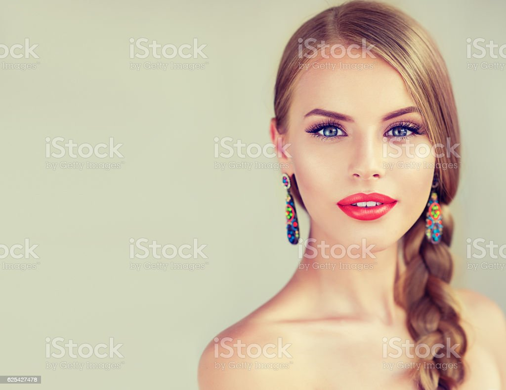 Beautiful young woman with braid(pigtail). - foto de acervo