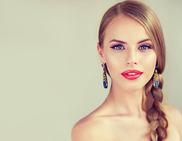 Beautiful young woman with braid(pigtail). stock photo