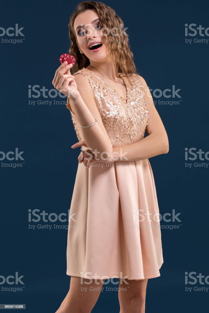 Beautiful young woman with casino chips on dark blue background - Royalty-free Adult Stock Photo
