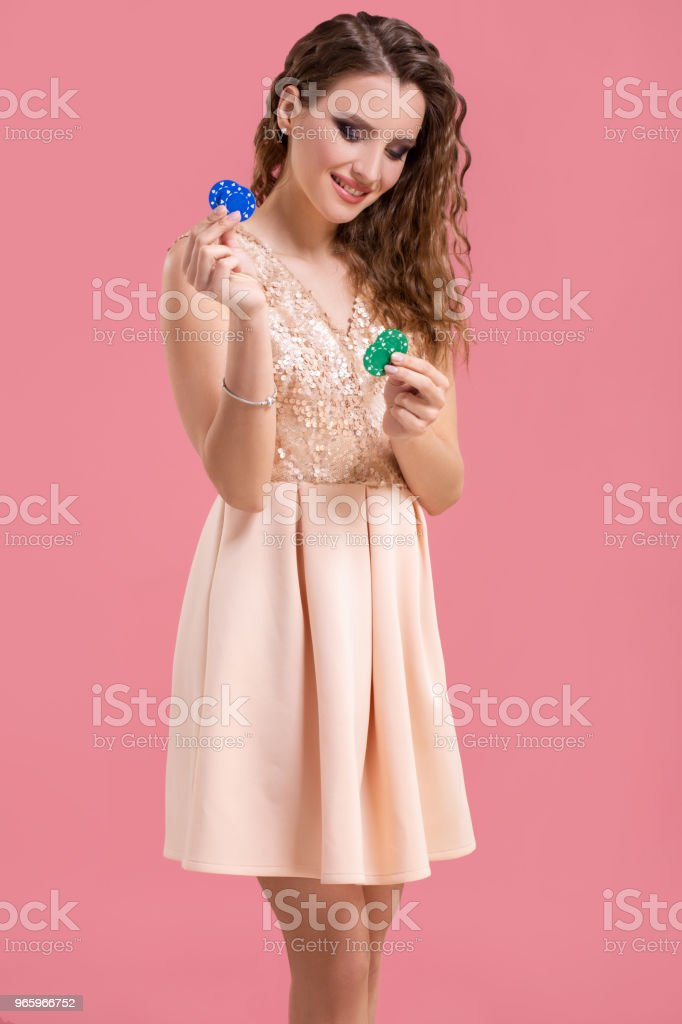 Beautiful young woman with casino chips on pink background - Royalty-free Adult Stock Photo