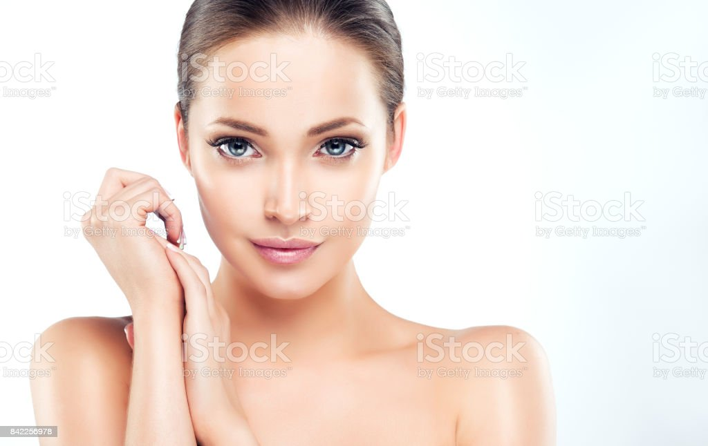 Beautiful young woman with clean, fresh and well groomed skin. stock photo