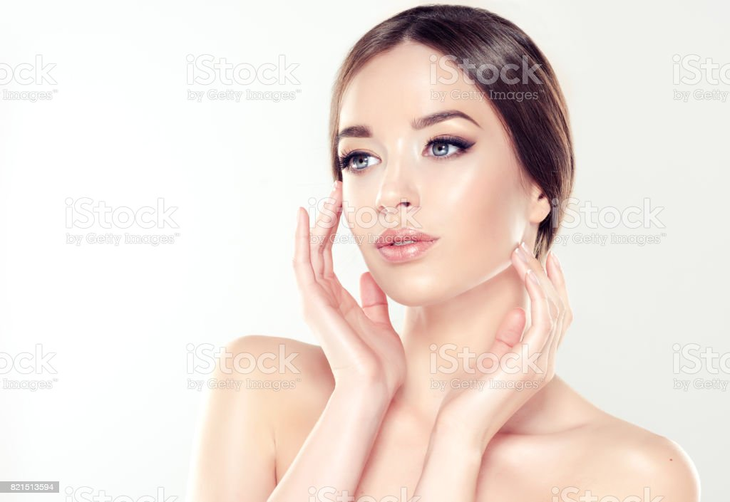 Beautiful young woman with clean fresh skin. Cosmetic and cosmetology. stock photo