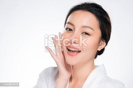 istock Beautiful Young Woman with Clean Fresh Skin 1144337675