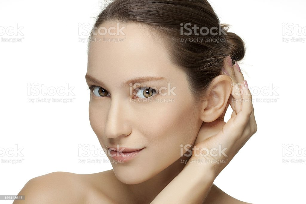 Beautiful young woman with clean skin of the face. royalty-free stock photo