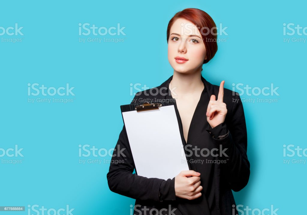 beautiful young woman with clipboard on the wonderful blue background royalty-free stock photo