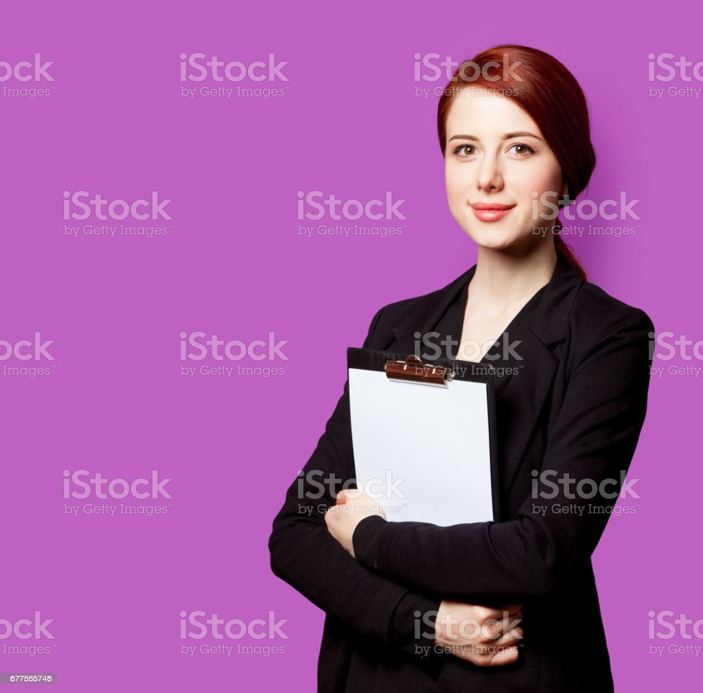 beautiful young woman with clipboard on the wonderful purple background royalty-free stock photo