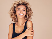 istock Beautiful young woman with curly hair 1148067797